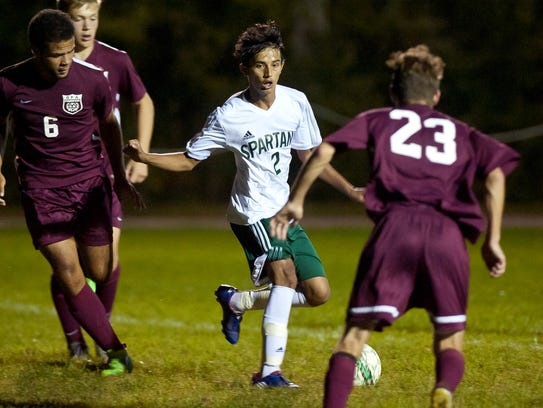 Lek Nath Luitel, center, Winooski enter the Division III boys soccer tournament with an undefeated record and the top seed.