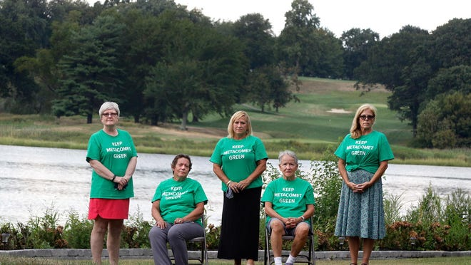 Founders of Keep Metacomet Green, from left, Roselette DeWitt, Lynn Miller, Jane Crevier, Candy Seel and Heather Andrade, with the Metacomet Golf Club behind them. Developers are proposing a mix of residential, retail and open space on the 138-acre property, and this group of neighbors has formed to fight the proposal.