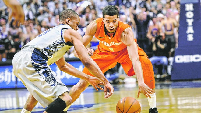 Georgetown guard Markel Starks, left, battles for the ball against Syracuse guard Michael Carter-Williams during a 2013 game in Washington.