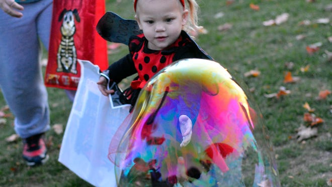 Super heroes, witches and ninja turtles show up in Shelly Park in West York for the Hallo-WE Together Fall Festival, Monday, October 31, 2016.  John A. Pavoncello photo