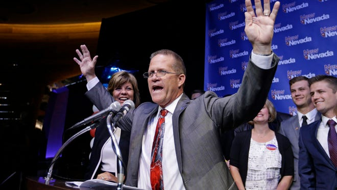 Lt. Governor candidate Mark Hutchison celebrates during his victory speech Tuesday, Nov. 4, 2014, in Las Vegas. Hutchison defeated Nevada state Democratic Assemblywoman Lucy Flores in the lieutenant governor race in Nevada. (AP Photo/John Locher)