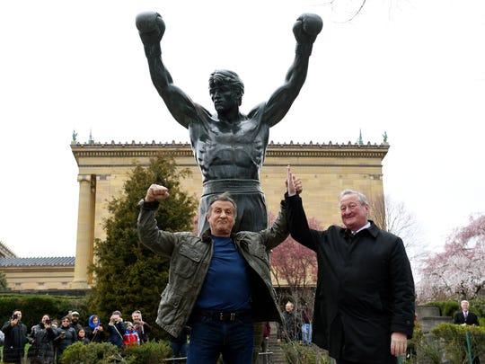 """Sylvester Stallone, left, poses with Philadelphia Mayor Jim Kenney in front of the Rocky statue at the Philadelphia Art Museum for a """"Creed II"""" photo op, Friday, April 6, 2018, in Philadelphia. The film, part of the """"Rocky"""" film franchise, will be released later this year."""