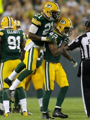 Green Bay Packers free safety Ha Ha Clinton-Dix celebrates with strong safety Morgan Burnett after a tackle against the Philadelphia Eagles Saturday, Aug. 29, 2015, at Lambeau Field in Green Bay.
