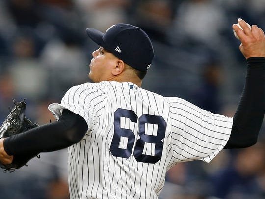 New York Yankees relief pitcher Dellin Betances (68) winds up in the ninth inning of a baseball game against the Kansas City Royals at Yankee Stadium in New York, Wednesday, May 24, 2017. The Yankees shut out the Royals 3-0.