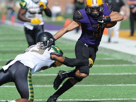 HSU's Matthew Sandoval, right, tries to break away