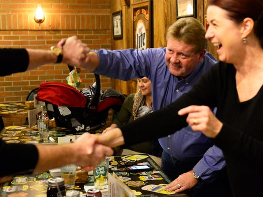 Jim Sleek, left, a Democrat elected to Fremont City Council's Second Ward,  celebrates Tuesday night with Holly Elder, incumbent Fremont treasurer who ran unopposed.