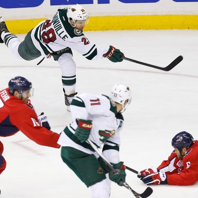 Mar 5, 2015; Washington, DC, USA; Minnesota Wild right wing Jason Pominville (29) scores the eventual game-winning goal as Washington Capitals defenseman Tim Gleason (6) defends in the third period at Verizon Center. The Wild won 2-1. Mandatory Credit: Geoff Burke-USA TODAY Sports