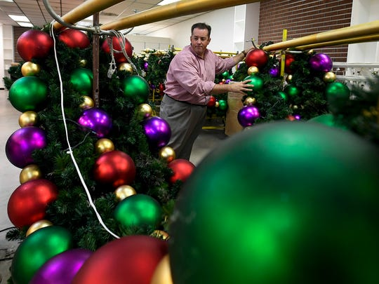 Mall Manager David Hagood looks through Christmas decorations