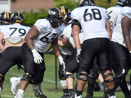 Southern Miss offensive linemen perform their drills