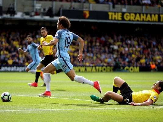 Manchester City's Leroy Sane centre controls the ball, during the English Premier League soccer match between Manchester City and Watford, at Vicarage Road, in Watford, England. (Steven Paston/PA/ via AP)
