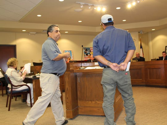 Former Abilene ISD board member Samuel Garcia, left, concludes his comments before the board Monday night to protest the selection process of the appointed Place 1 member, Tim de la Vega. Joining Garcia at the podium but not speaking was LULAC chapter 605 president James Lemon.