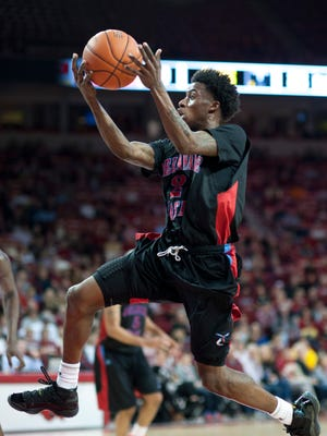 Delaware State's Kendal Williams leaps to the basket in the first half against Arkansas on Friday in Fayetteville, Arkansas.