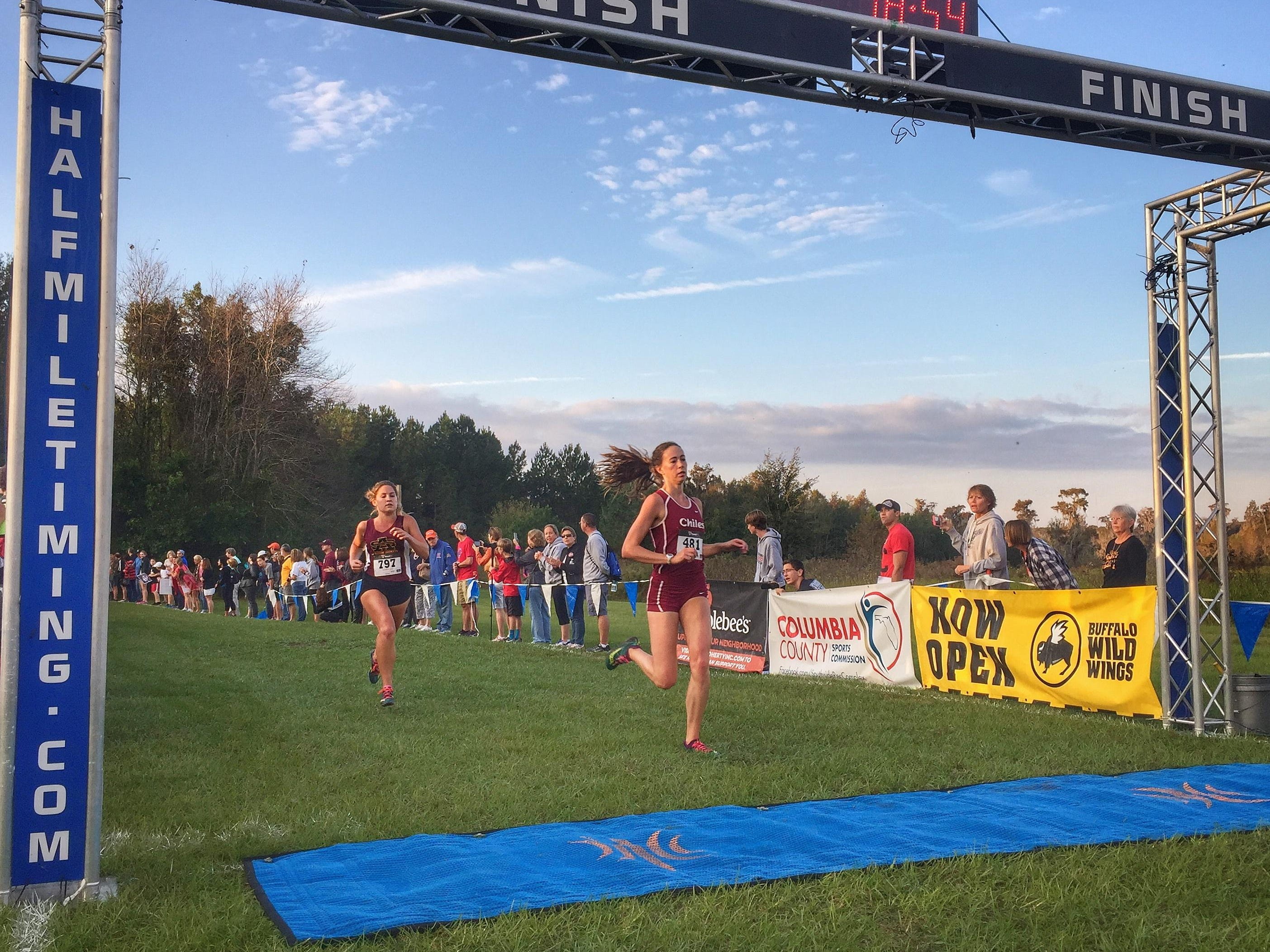 Chiles senior Emma Tucker finished third at Saturday's Region 1-3A meet in Lake City, while the Timberwolves were the region runner-up.