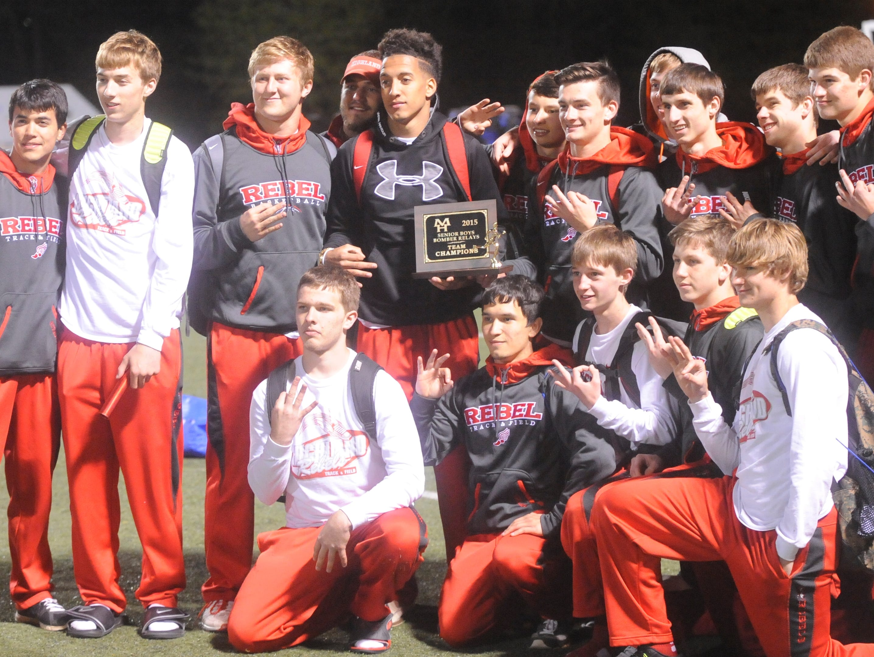 The Highland Rebels pose with the championship trophy of the 2015 Bomber Relays on Monday night at Bomber Stadium. It was the third straight year the Rebels won the Mountain Home meet.