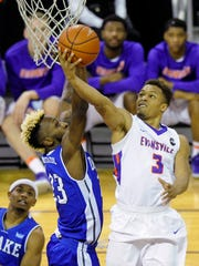 Evansville Aces guard Jaylon Brown (3) scores past