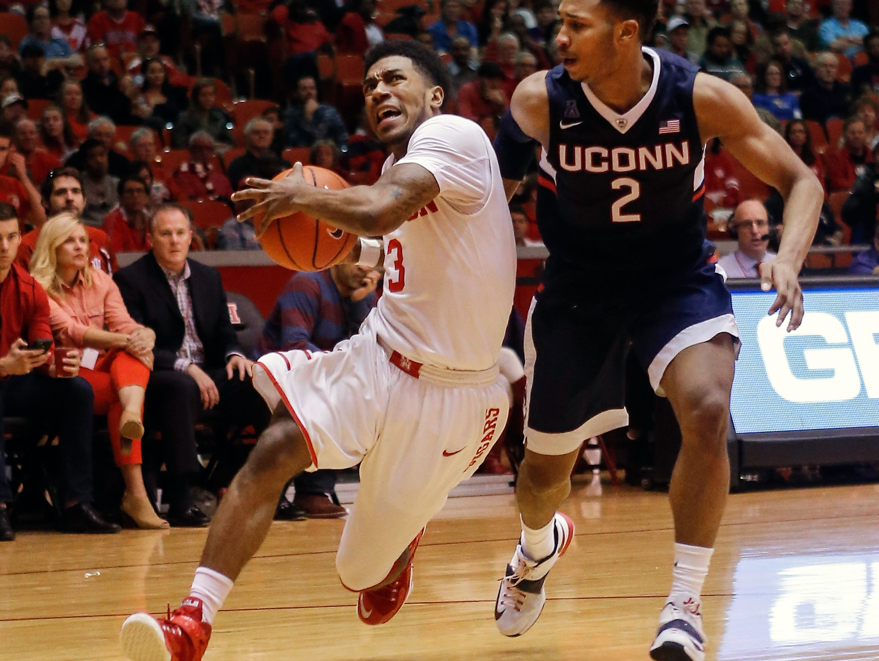 Houston guard Ronnie Johnson (3) drove around Connecticut guard Jalen Adams (2) during a game in January. Johnson, formerly of North Central and Purdue, is seeking to leave Houston now. Sunday, Jan. 17, 2016 in Houston. Connecticut won 69-57. (AP Photo/Bob Levey)