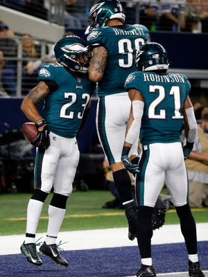 Philadelphia Eagles' Rodney McLeod (23), Derek Barnett (96) and Patrick Robinson (21) celebrate an interception by McLead of a Dallas Cowboys' Dak Prescott pass in the first half of an NFL football game, Sunday, Nov. 19, 2017, in Arlington, Texas. The Eagles' in-depth preparation before games has led to them going 9-1 and reeling off three consecutive lopsided victories. (AP Photo/Michael Ainsworth)