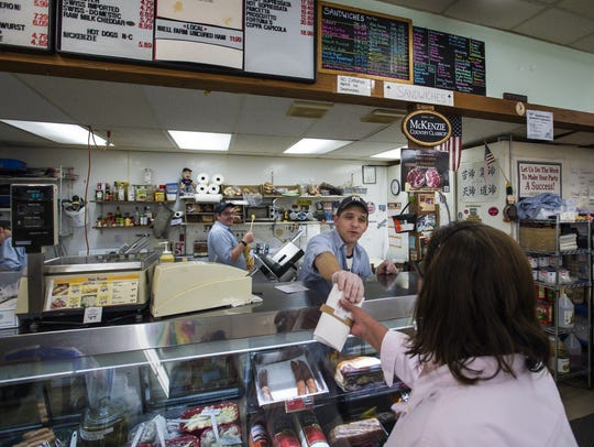 Deli Manager Nate Pierce helps a customer at Mehuron's