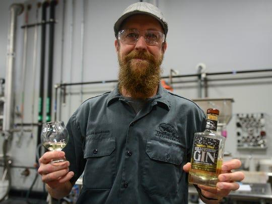 Dogfish Head's lead distiller Graham Hamblett holds
