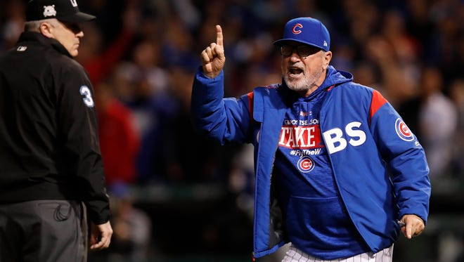 Cubs manager Joe Maddon argues a reviewed foul ball call.