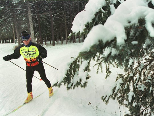 A cross-country skier explores the Brown County Reforestation Camp