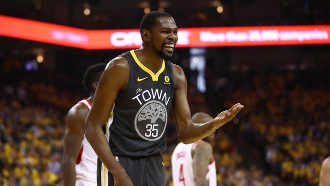 Kevin Durant reacts to a play during the Golden State Warriors' Game 4 loss to the Houston Rockets.