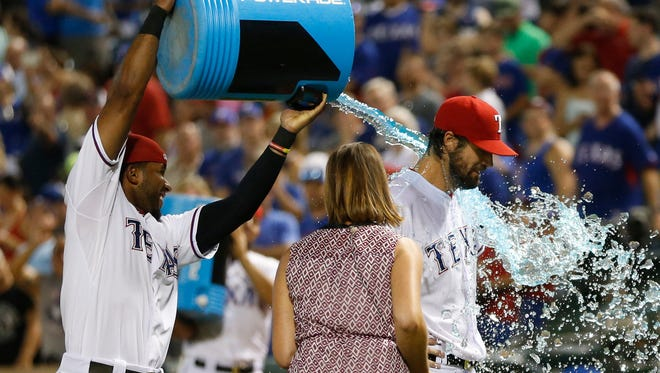 Texas Rangers shortstop Elvis Andrus (1) dunks water on Texas Rangers starting pitcher Cole Hamels (35) after the game against the Baltimore Orioles at Globe Life Park in Arlington. Texas won 4-1.