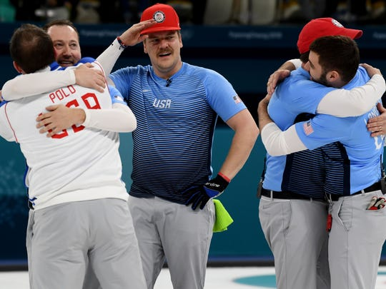 Feb. 24: Team USA celebrates winning the gold medal in curling  at Gangneung Curling Centre.