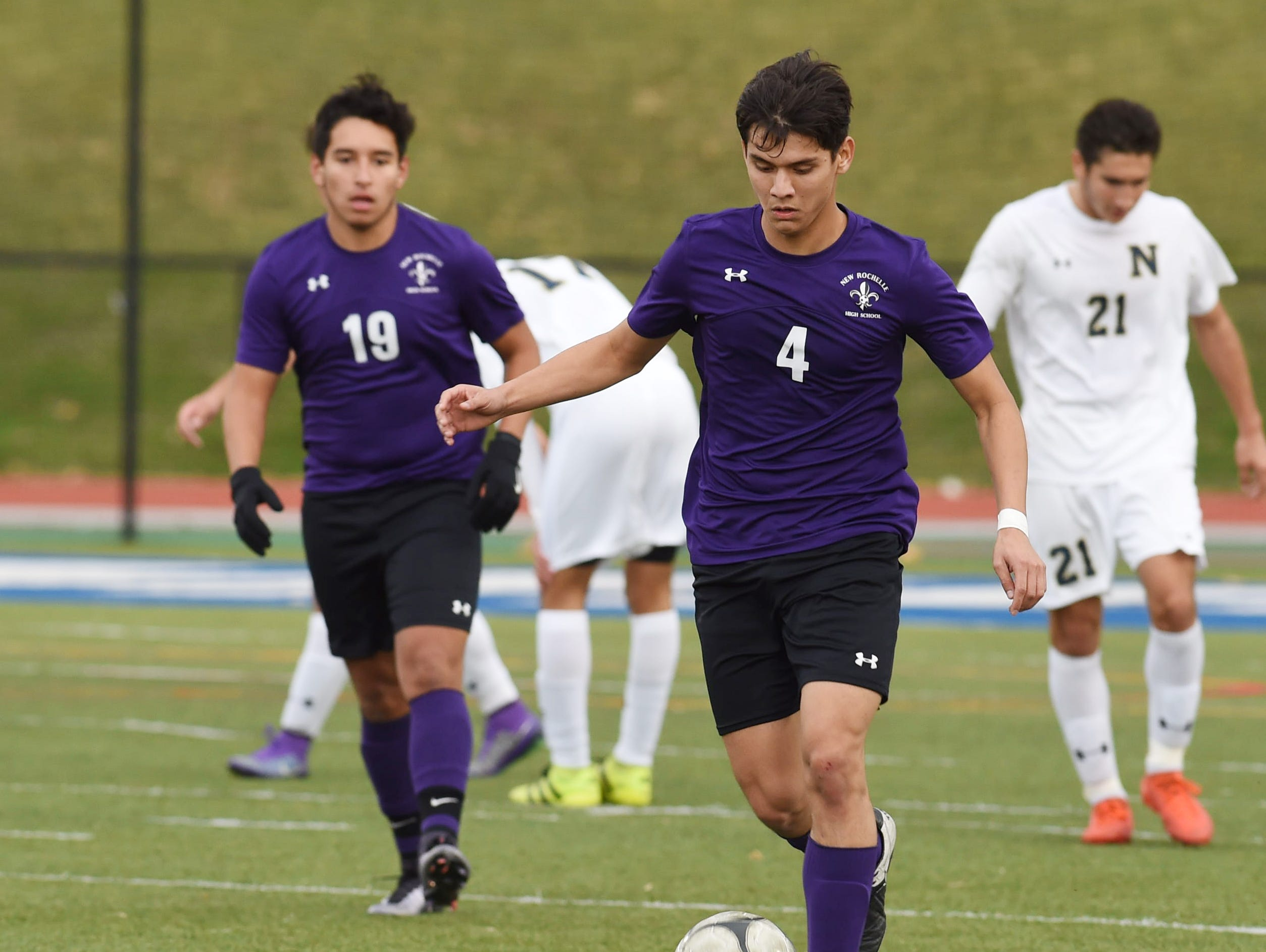 New Rochelle's Marcos Garcia takes the ball down the field during Saturday's Class AA regional final against Newburgh.