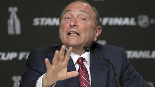FILE - In this May 27, 2019, file photo, NHL Commissioner Gary Bettman speaks to the media before Game 1 of the NHL hockey Stanley Cup Finals between the St. Louis Blues and the Boston Bruins, in Boston. A comprehensive COVID-19 testing strategy is part of a potential NHL return.