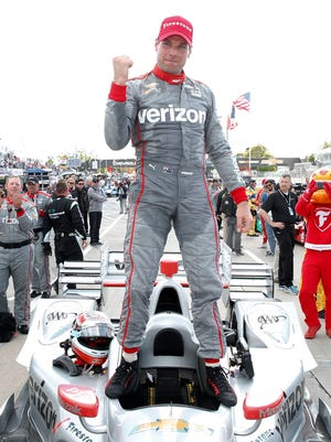 Will Power, here celebrating winning race two of the IndyCar Detroit Grand Prix double header on June 5, won the pole Saturday for Sunday's Kohler Grand Prix.