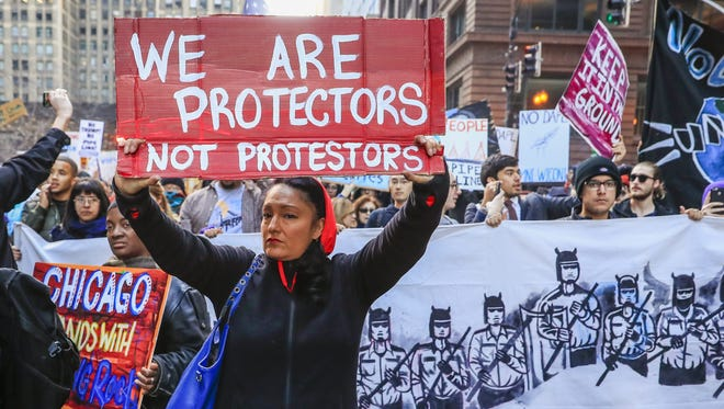 Native American protesters march showing their opposition to the Dakota Access Pipeline, in Chicago on Nov. 12, 2016.