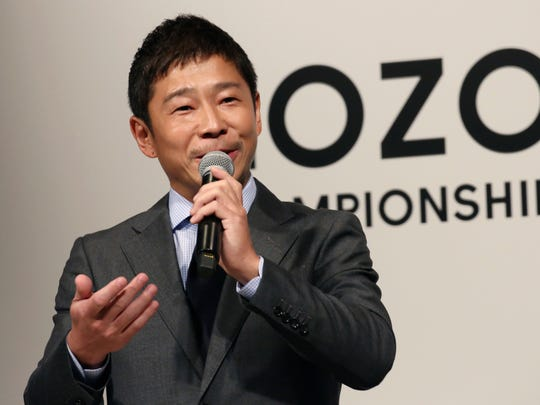 "ZOZO Inc. President Yusaku Maezawa speaks during a press conference on the PGA Tour in Tokyo, Tuesday, Nov. 20, 2018. The PGA Tour will hold its first official tournament, the Zozo Championship, in Japan. And the main sponsor of next year's event, Japanese billionaire Maezawa, is calling the tournament a kind of ""moonshot"" for golf in his country. Maezawa was announced earlier this year as the first commercial passenger to attempt a flyby around the moon. (AP Photo/Koji Sasahara)"