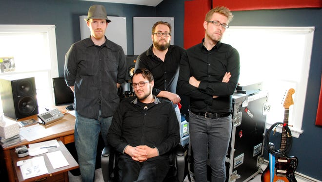 The Lambertville-based power-pop band The Paper Jets will introduce new songs from a forthcoming fifth when when they make their Court Tavern debut on May 7. Pictured from left to right are bassist Scott Austin Miller, drummer-engineer Frank Lettieri Jr., lead guitarist Mike Virok and, seated, vocalist-guitarist-keyboardist Brian Erickson.