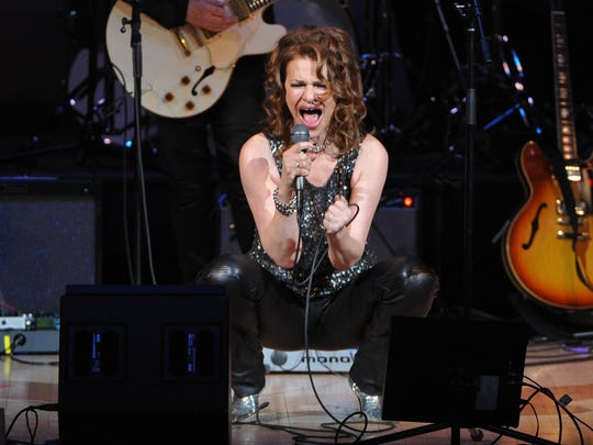 """Actress and singer Sandra Bernhard performs at """"The Music of Prince"""" tribute concert at Carnegie Hall in New York in 2013."""