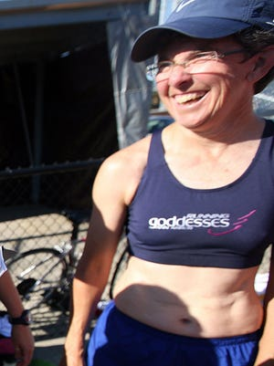 Karen McKeachie, a member of the Running Goddesses track club takes a break during practice at the University of Michigan in Ann Arbor Tuesday, July 15, 2008.