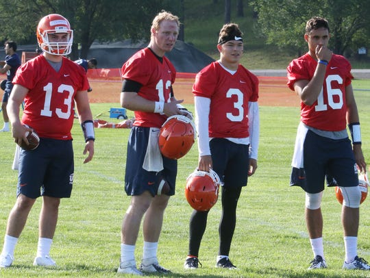UTEP quarterbacks take a break Wednesday at Camp Ruidoso.