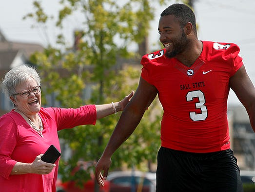 Nick Miles, #3, has a laugh with Jayne Powers. Ball State players gathered and walked through downtown interacting with fans and building links to the community. They spent much of their time at Canan Commons. Players will also be at the Southside Walmart and in Yorktown (business district and sports complex). Miles was an intern this summer at MutualBank where Powers works.