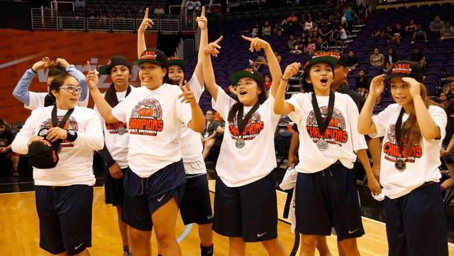 Nez Pearce teammates celebrate winning the 2015 Native American Basketball Invitational Gold Championship.