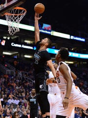 Jan 30, 2017; Phoenix, AZ, USA; Memphis Grizzlies forward Chandler Parsons (25) lays up the ball in front of Phoenix Suns forward Marquese Chriss (0) in the first half of the NBA game at Talking Stick Resort Arena. Mandatory Credit: Jennifer Stewart-USA TODAY Sports
