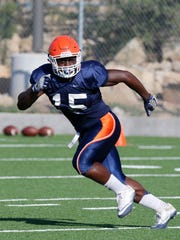 UTEP running back Kevin Dove not only helps out int