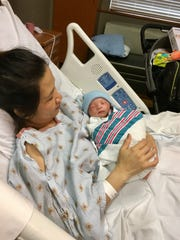 Dai Nguyen holds baby boy Tien, the first baby born in Lafayette in 2018. Tien was born at 3:52 a.m. at Lafayette General Medical Center.