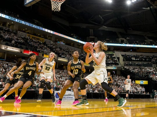 Zionsville High School junior guard Maddie Nolan (24) takes the ball to the basket as she's defended by Warren Central High School junior guard Shaila Beeler (10) during the first half of the 43rd Annual IHSAA Girls Basketball State Finals class 4A championship game, Saturday, February 24, 2018, at Bankers Life Fieldhouse in Indianapolis.