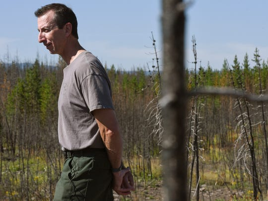 In a July 22, 2018 photo, John Cataldo, Yellowstone National Park's fire manager, speaks during a tour of the 1988 burn scar, an area that burned again in 2016 during the Maple fire.  (Rachel Leathe/Bozeman Daily Chronicle via AP)