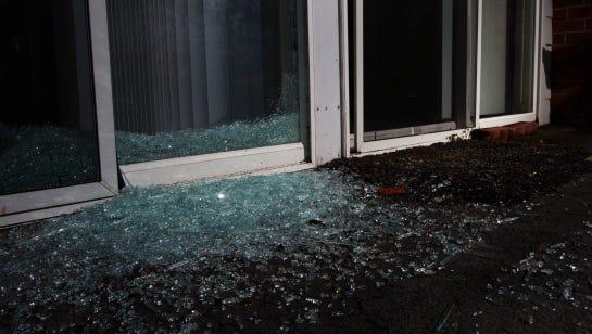 Stock image of a broken glass door or windows.