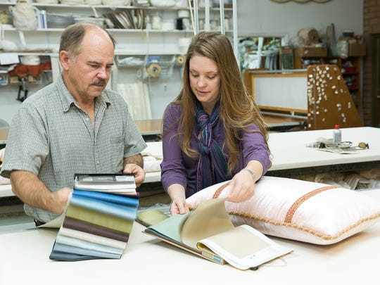 Spring Crest Custom Draperies owners Rob Kosnick, 61, and his daughter Jenni work with materials on Monday at the store. On Jan 15, 2016 the family-owned store will be celebrating its 40th anniversary.