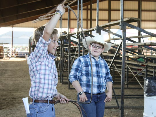Logan Thurman, 11, and Chirs Carbin, 11, try to learn
