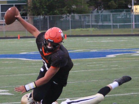 Brother Rice quarterback Mariano Valenti can't escape