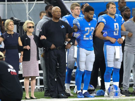 The Detroit Lions took a knee and joined arms in protest of statements made by President Donald Trump before action against the Atlanta Falcons on Sunday, Sept. 24, 2017 at Ford Field in Detroit.