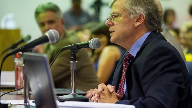Billy Guidry, chief financial officer of the Lafayette Parish School System, answers questions from school board members during a Lafayette Parish School Board meeting in Lafayette, LA, Thursday, June 19, 2014.  Paul Kieu, The Advertiser